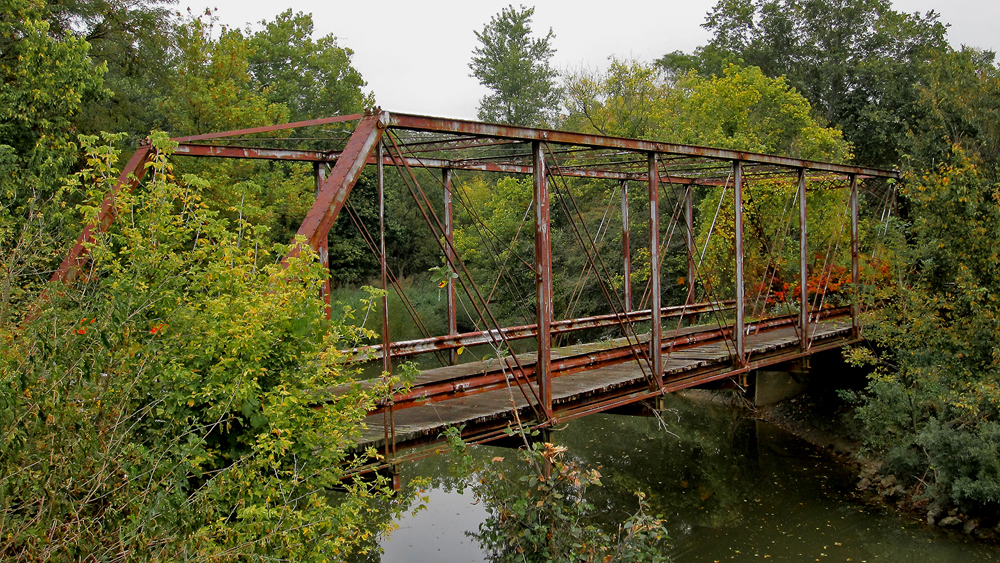 This abandoned bridge, located in Tully Township, crosses the Olentangy River and is visible from Morral-Kirkpatrick Road East. It dates to 1876 and was constructed by the Wrought Iron Bridge Company.