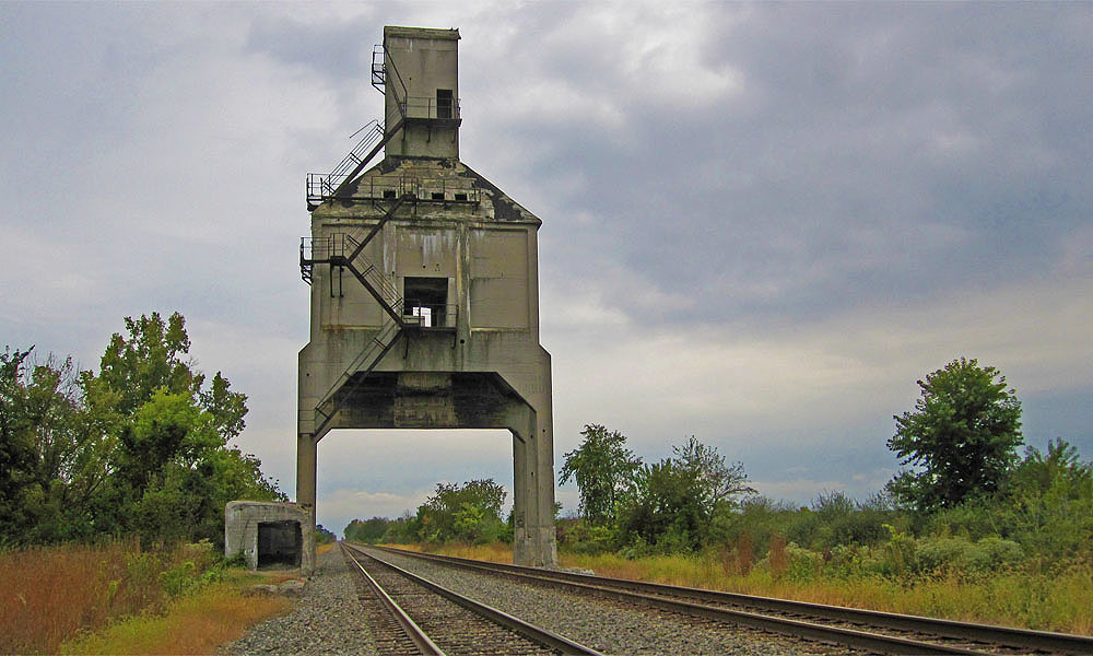This structure, located near Grandview Estates north of town, is called a coal tipple, and many years ago its purpose was to supply steam locomotives with both coal for their fireboxes and water for the boilers. According to Harry Titus, the structure was saved from demolition when an American Eagle nest was discovered in it. In any case, the coal tipple was once a popular hang out where local teenagers would to drink and flirt and generally behave recklessly while trains raced below them.