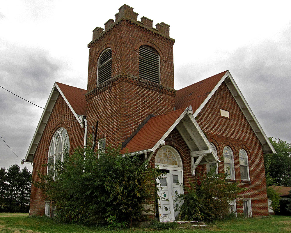 Located on the corner of Pole Lane Road and Likens Road, this church, known by many as Likens Chapel, dates to 1917 and replaced the original church that stood at this location. During WWII, the US government took much of the land in that area for the Scioto Ordinance Plant, and the church was forced to close its doors. By 1950, however, church services were once again taking place there. Nevertheless, by the 1980s the congregation had dwindled to such an extent that the church disbanded. Since then, the church has generally stood empty (though at one point a family was using the church as a private residence).