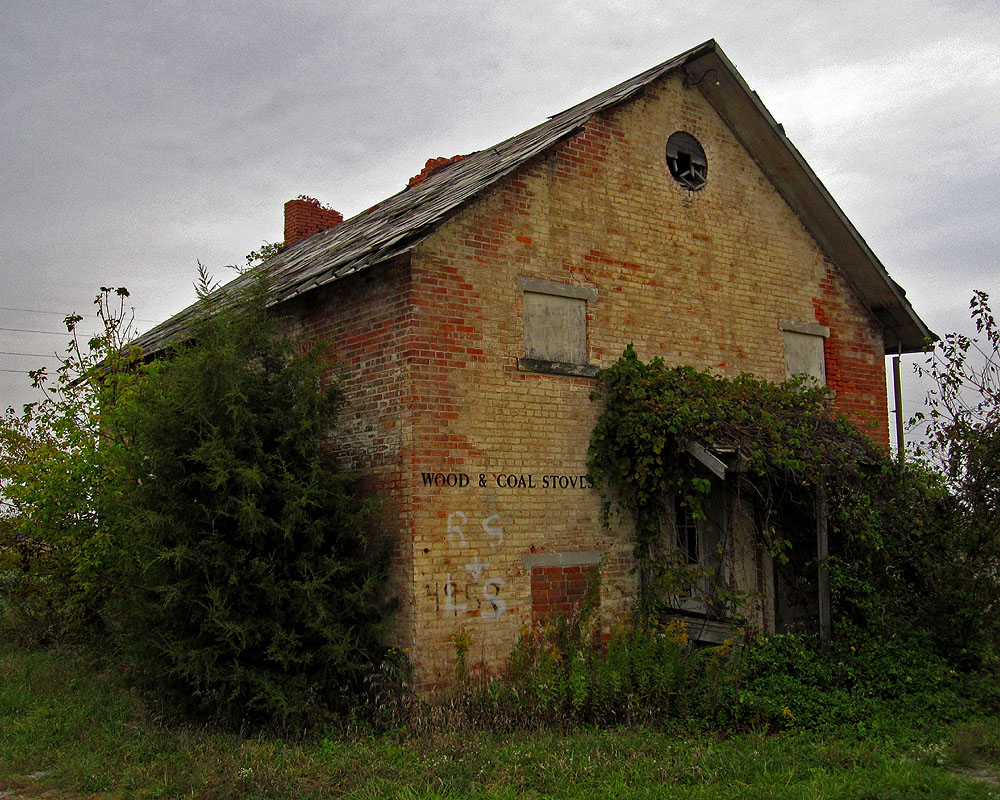 "According to Willis Thomas' book The Schools of Marion County, Ohio, this building, located near the intersection of Marion-Bucyrus Road and Morral-Kirkpatrick Road, was once known as the ""Hill School"" and dates to at least 1869. The school was later owned by the Mitchell family, and they ran various businesses (e.g. repairing chainsaws, selling wood-burning stoves) out of it for years."